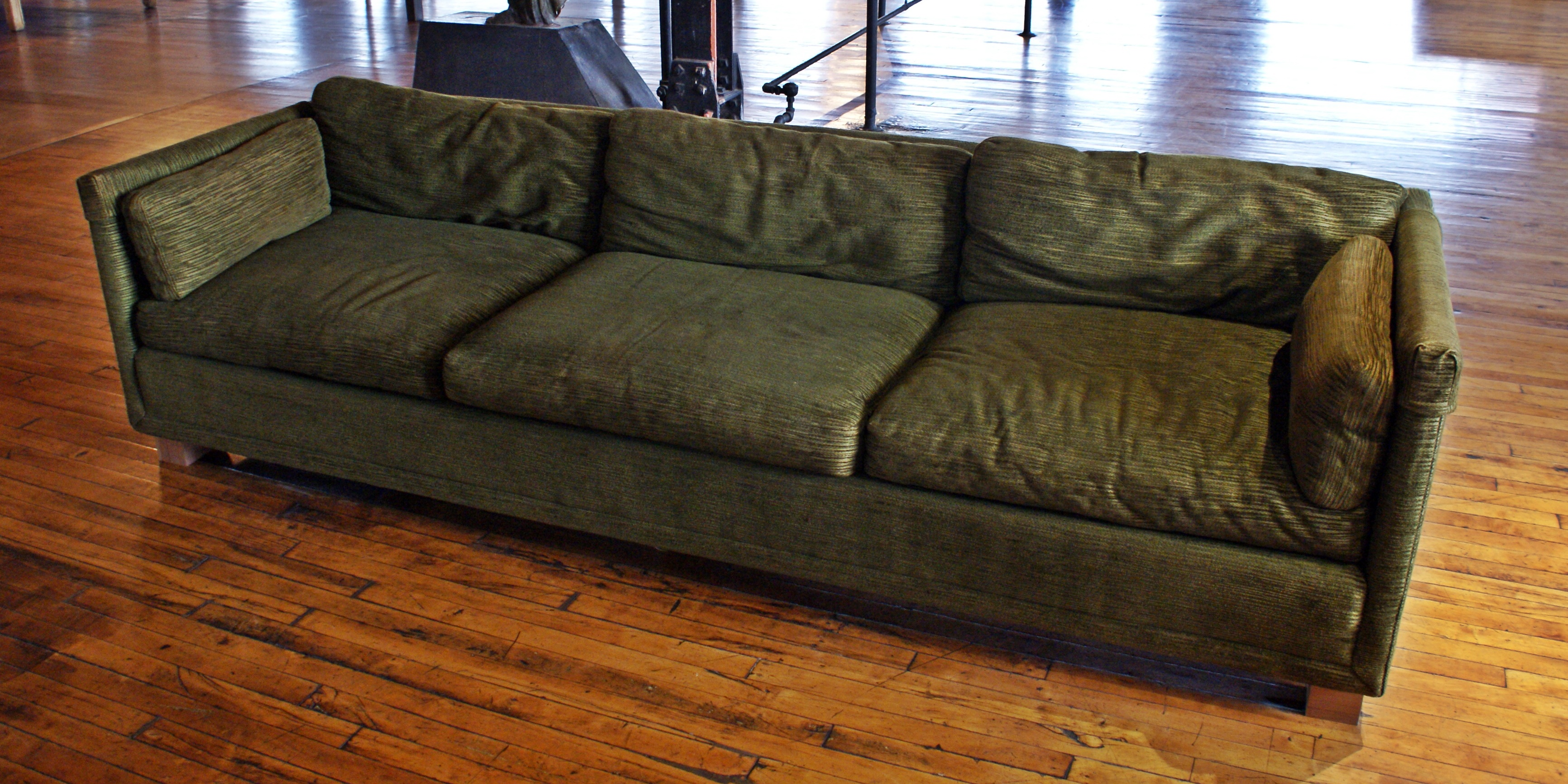 Dark Green MCM Sofa On Casters